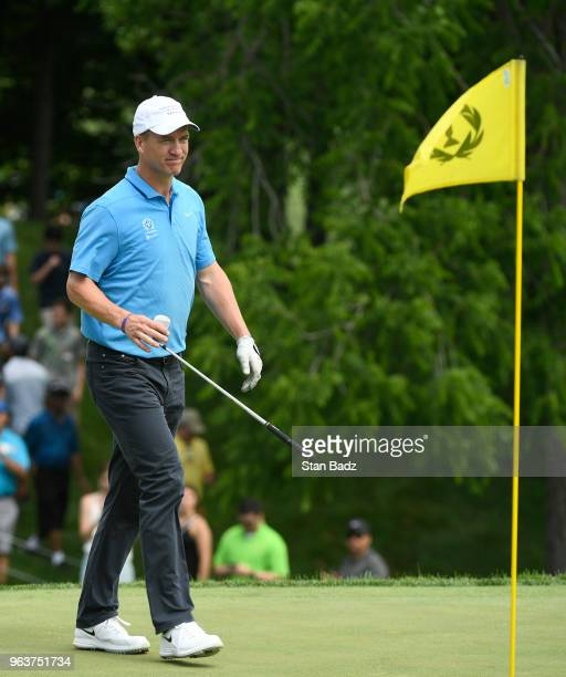 Peyton Manning approaches the 18th green during the ProAm round to the Memorial Tournament presented by Nationwide at Muirfield Village Golf Club on...