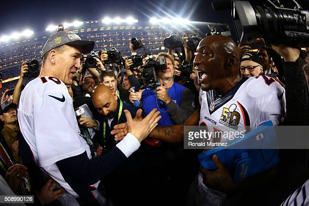 Peyton Manning celebrates with Aqib Talib of the Denver Broncos after defeating the Carolina Panthers 2410 during Super Bowl 50 at Levi's Stadium on...