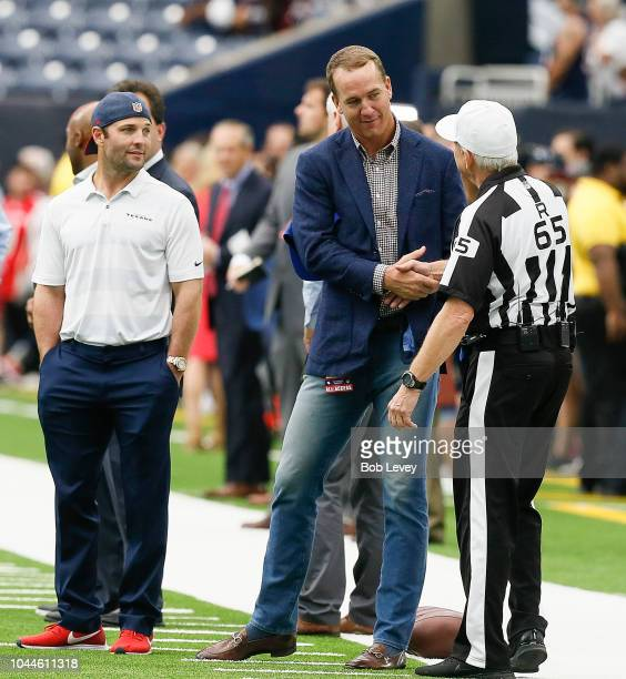 Peyton Manning center and Wes Welker talk with referee Walt Coleman during warm ups before the New York Giants play the Houston Texans at NRG Stadium...