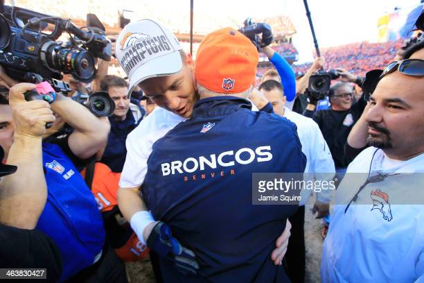 Peyton Manning embraces head coach John Fox of the Denver Broncos after they defeated the New England Patriots 26 to 16 during the AFC Championship...