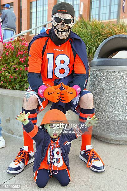 Peyton Manning fan poses for a photograph outside Lucas Oil Stadium prior to a game between the Indianapolis Colts and the Denver Broncos on October...