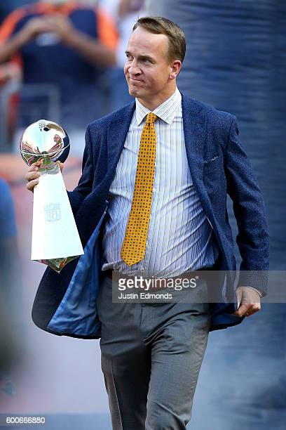 Peyton Manning holds the Lombardi Trophy to celebrate the Denver Broncos in win Super Bowl 50 at Sports Authority Field at Mile High before taking on...