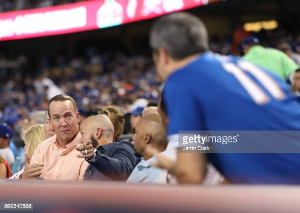 Peyton Manning jokes with Actor Troy Garity during The 2017 World Series Game 2 at Dodger Stadium on October 25 2017 in Los Angeles California
