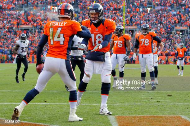 Peyton Manning oand Brandon Stokley of the Denver Broncos celebrate after Stokley caught a 15yard toucdown reception in from Manning in the first...