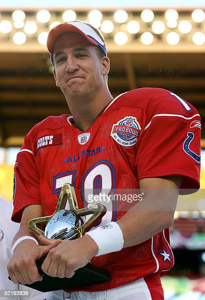 Peyton Manning of the AFC team holds his MVP trophy after the NFL Pro Bowl on February 13 2005 at Aloha Stadium in Honolulu Hawaii The AFC team beat...