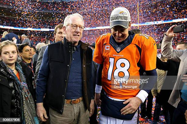 Peyton Manning of the Denver Broncos and father Archie Manning walk off the field after defeating the New England Patriots in the AFC Championship...