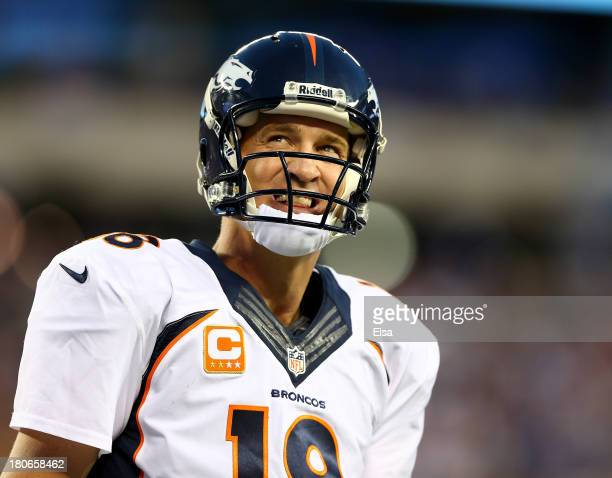 Peyton Manning of the Denver Broncos celebrates a touchdown in the fourth quarter against the New York Giants at MetLife Stadium on September 15 2013...