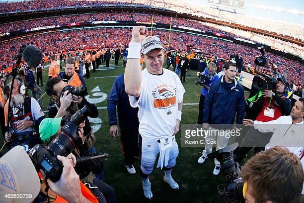 Peyton Manning of the Denver Broncos celebrates after they defeated the New England Patriots 26 to 16 during the AFC Championship game at Sports...