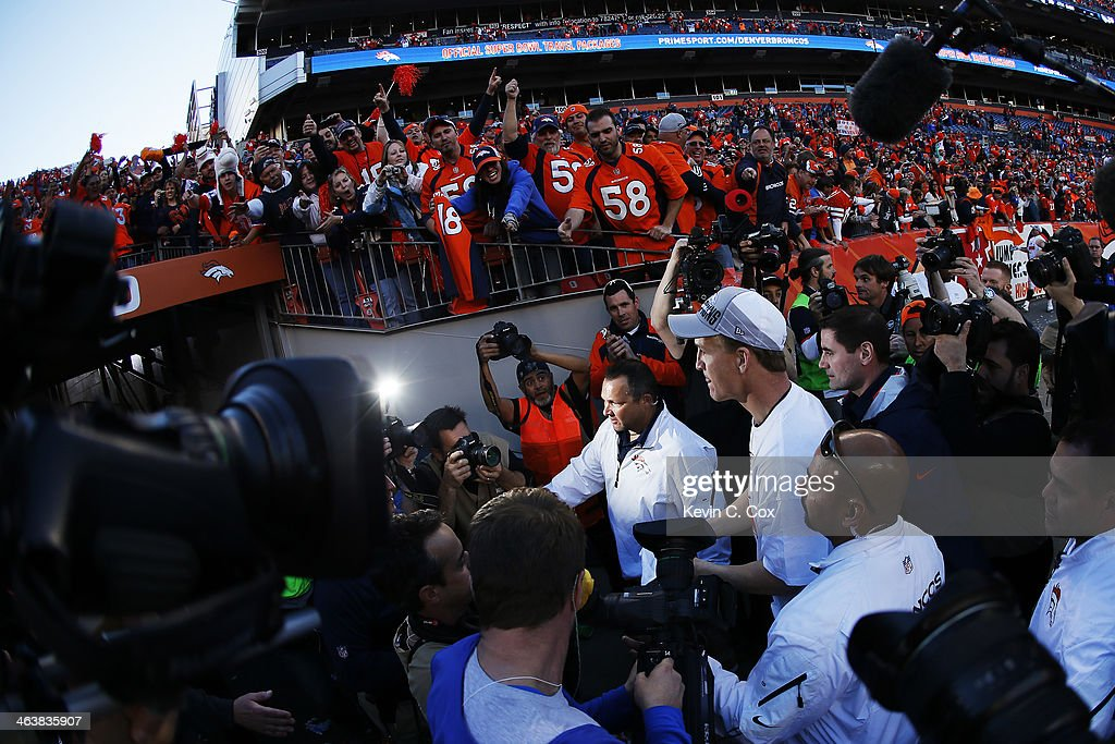 Peyton Manning #18 of the Denver Broncos celebrates after they defeated the New England Patriots 26 to 16 during the AFC Championship game at Sports Authority Field at Mile High on January 19, 2014 in Denver, Colorado.