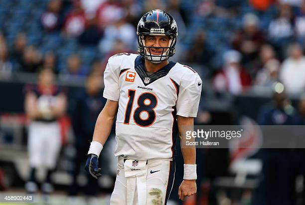 Peyton Manning of the Denver Broncos celebrates after throwing his fourth touchdown during the game against the Houston Texans at Reliant Stadium on...