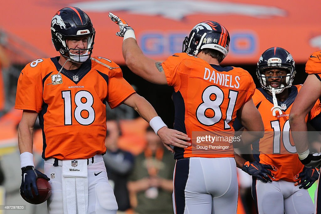 Peyton Manning #18 of the Denver Broncos celebrates with Owen Daniels #81 of the Denver Broncos as Manning sets the NFL career passing yards record with a four yard completion to Ronnie Hillman #23 of the Denver Broncos against the Kansas City Chiefs in the first quarter at Sports Authority Field at Mile High on November 15, 2015 in Denver, Colorado. Mannning passes Bret Farve who previously held the record at 71, 838 yards.