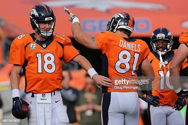 Peyton Manning of the Denver Broncos celebrates with Owen Daniels of the Denver Broncos as Manning sets the NFL career passing yards record with a...
