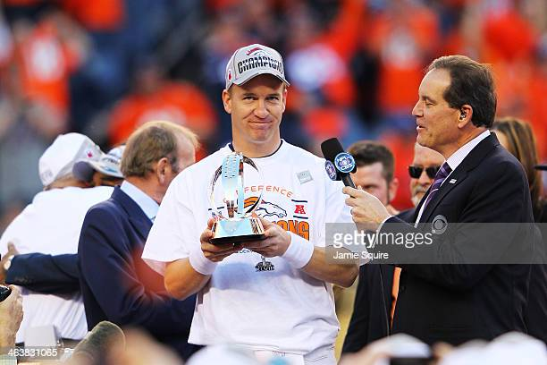 Peyton Manning of the Denver Broncos celebrates with the Lamar Hunt Trophy after they defeated the New England Patriots 26 to 16 in the AFC...