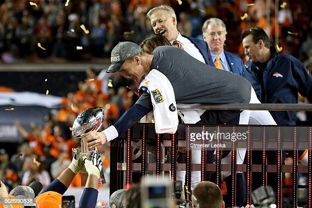 Peyton Manning of the Denver Broncos hands the Vince Lombardi Trophy to teammates after winning Super Bowl 50 at Levi's Stadium on February 7 2016 in...