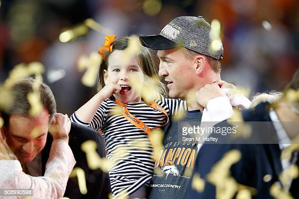 Peyton Manning of the Denver Broncos holds his daughter Mosley after the Denver Broncos defeated the Carolina Panthers with a score of 24 to 10 to...