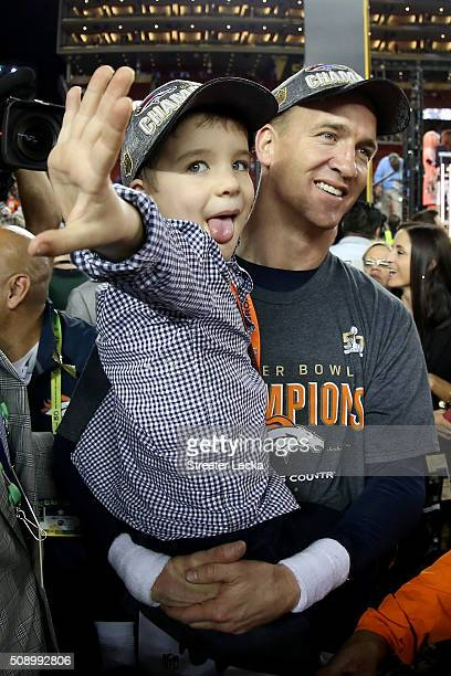 Peyton Manning of the Denver Broncos holds his son Marshall after the Denver Broncos defeated the Carolina Panthers with a score of 24 to 10 to win...