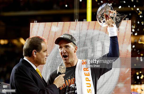 Peyton Manning of the Denver Broncos is interviewed by Jim Nantz after Super Bowl 50 at Levi's Stadium on February 7 2016 in Santa Clara California...