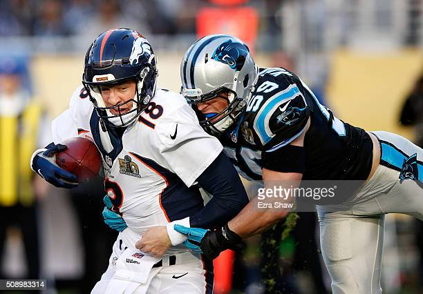 Peyton Manning of the Denver Broncos is tackled by Luke Kuechly of the Carolina Panthers in the first quarter during Super Bowl 50 at Levi's Stadium...