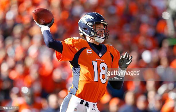 Peyton Manning of the Denver Broncos looks to pass in the first quarter against the New England Patriots in the AFC Championship game at Sports...