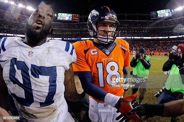 Peyton Manning of the Denver Broncos meets Arthur Jones of the Indianapolis Colts following a 2015 AFC Divisional Playoff game at Sports Authority...