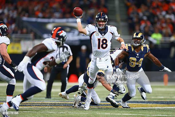 Peyton Manning of the Denver Broncos passes the ball to Montee Ball of the Denver Broncos against the St Louis Rams in the first quarter at the...