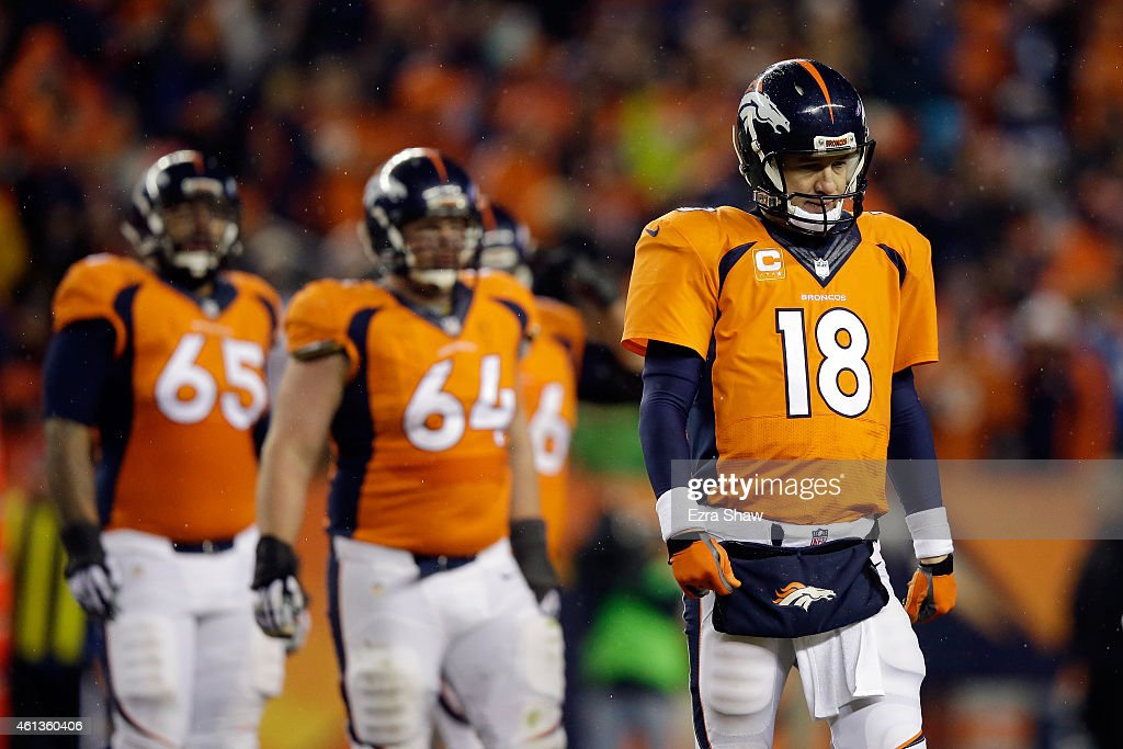 Peyton Manning #18 of the Denver Broncos reacts in the fourth quarter against the Indianapolis Colts during a 2015 AFC Divisional Playoff game at Sports Authority Field at Mile High on January 11, 2015 in Denver, Colorado. The Colts defeated the Broncos 24-13.
