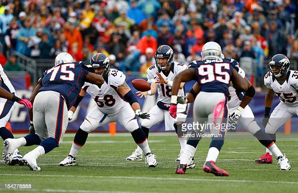 Peyton Manning of the Denver Broncos receives the ball behind center against the New England Patriots during the game on October 7 2012 at Gillette...