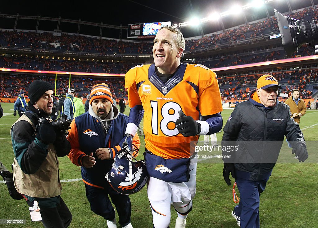 Peyton Manning #18 of the Denver Broncos runs off of the feild after their 24 to 17 win over the San Diego Chargers during the AFC Divisional Playoff Game at Sports Authority Field at Mile High on January 12, 2014 in Denver, Colorado.