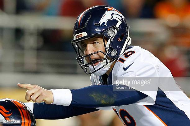 Peyton Manning of the Denver Broncos signals at the line of scrimmage in the second half against the Carolina Panthers during Super Bowl 50 at Levi's...