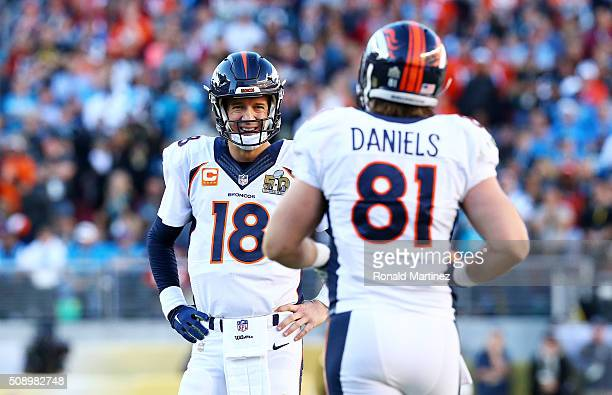 Peyton Manning of the Denver Broncos stands on the field with Owen Daniels of the Denver Broncos in the first quarter during Super Bowl 50 at Levi's...