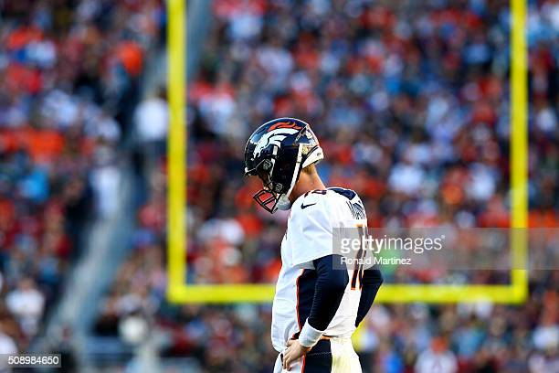 Peyton Manning of the Denver Broncos stands on the sideline in the first half against the Carolina Panthers during Super Bowl 50 at Levi's Stadium on...
