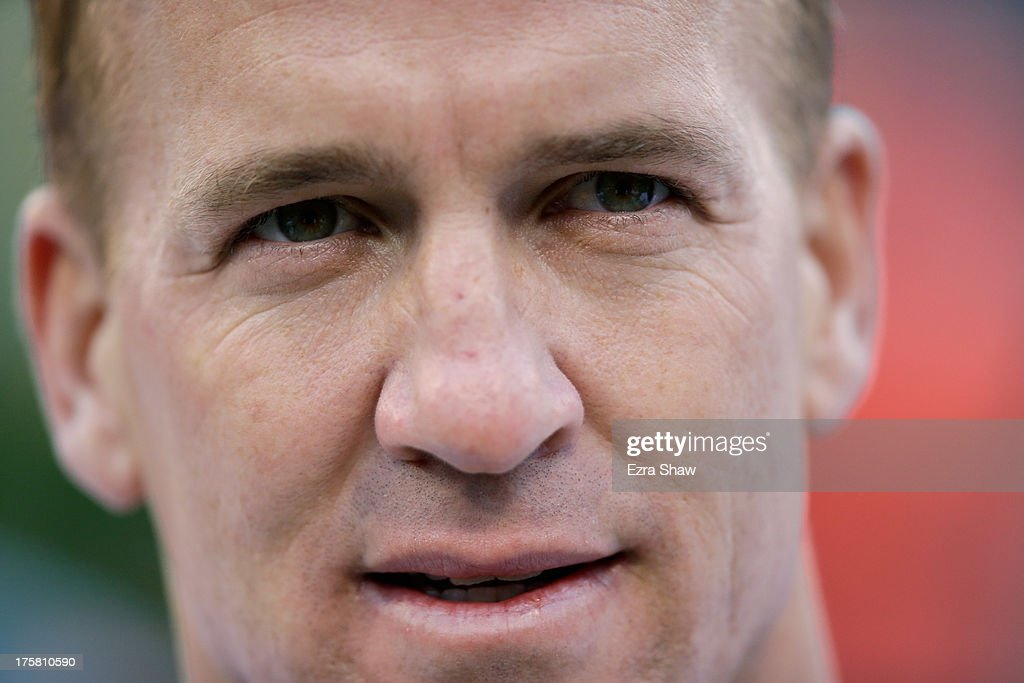 Peyton Manning #18 of the Denver Broncos stands on the sidelines during their preseason NFL game against the San Francisco 49ers at Candlestick Park on August 8, 2013 in San Francisco, California.