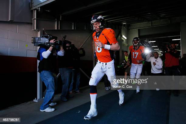 Peyton Manning of the Denver Broncos takes the field to warm up prior to their AFC Championship game against the New England Patriots at Sports...