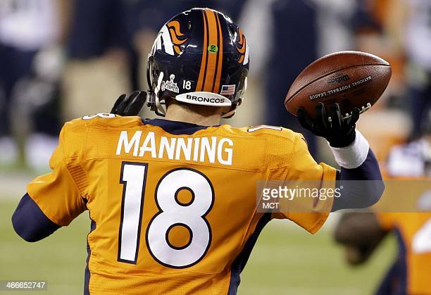 Peyton Manning of the Denver Broncos throws a pass against the Seattle Seahawks during the second half of Super Bowl XLVIII at MetLife Stadium in...