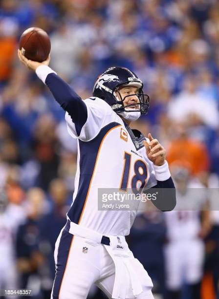 Peyton Manning of the Denver Broncos throws a touchdown pass in the first quarter against the Indianapolis Colts at Lucas Oil Stadium on October 20...