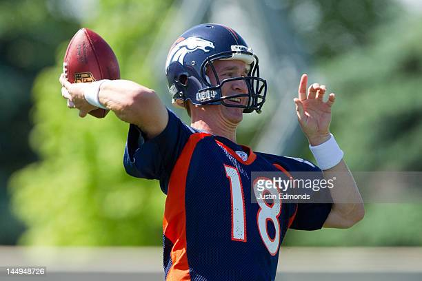 Peyton Manning of the Denver Broncos throws during organized team activities at Dove Valley on May 21, 2012 in Englewood, Colorado.
