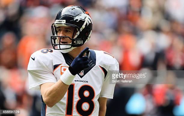 Peyton Manning of the Denver Broncos waits for a play during the first half of the game against the Houston Texans at Reliant Stadium on December 22,...