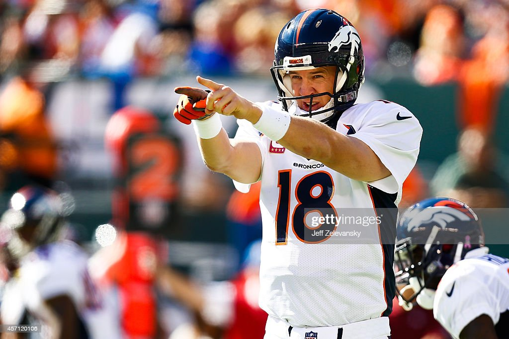 Peyton Manning #18 of the Denver Broncos yells to teammates in the second quarter during a game against the New York Jets at MetLife Stadium on October 12, 2014 in East Rutherford, New Jersey.