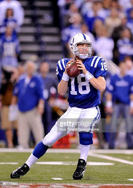 Peyton Manning of the Indianapolis Colts drops back to pass during a game against the New York Jets in the AFC Championship Game at Lucas Oil Stadium...