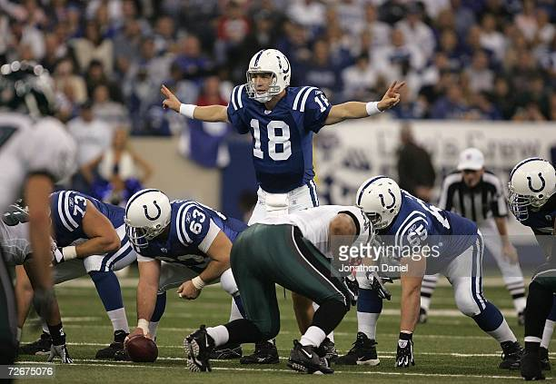 Peyton Manning of the Indianapolis Colts gestures at the line of scrimmage behind center Jeff Saturday against the Philadelphia Eagles November 26...