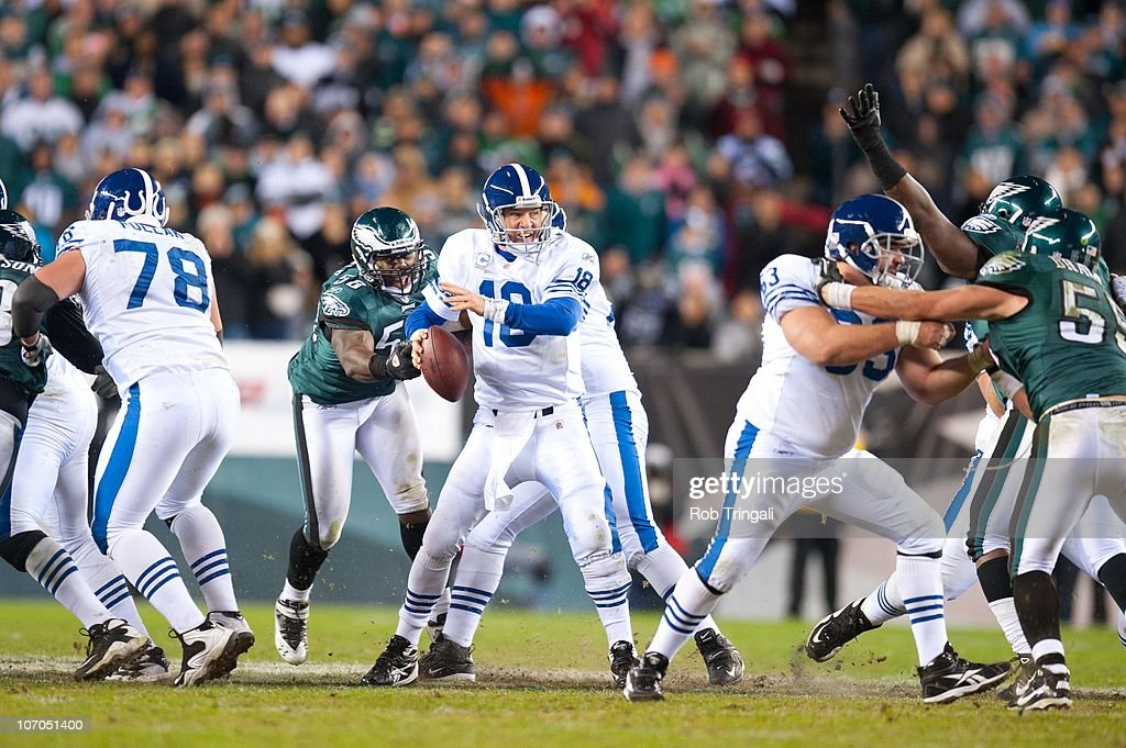 Indianapolis Colts - 2010 Throwbacks Peyton-manning-of-the-indianapolis-colts-is-pressured-by-the-eagles-picture-id107051400