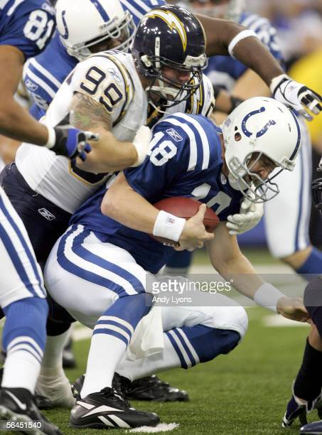 Peyton Manning of the Indianapolis Colts is sacked by Igor Olshansky of the San Diego Chargers during the NFL game at the RCA Dome on December 18...