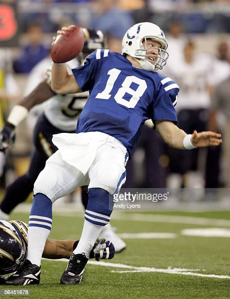 Peyton Manning of the Indianapolis Colts is sacked by Shawne Merriman of the San Diego Chargers during the NFL game at the RCA Dome on December 18...