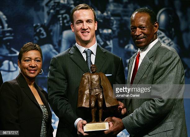 Peyton Manning of the Indianapolis Colts poses Connie Payton wife of deceased star Walter Payton and Gene Upshaw President of the NFL Players...