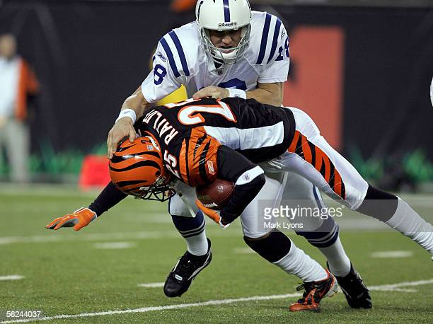 Peyton Manning of the Indianapolis Colts tackles Keiwan Ratliff of the Cincinnati Bengals after Ratliff intercepted a pass from Manning during the...