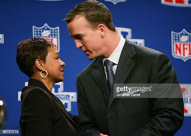 Peyton Manning of the Indianapolis Colts thanks Connie Payton wife of deceased star Walter Payton during the Walter Payton Man of the Year...