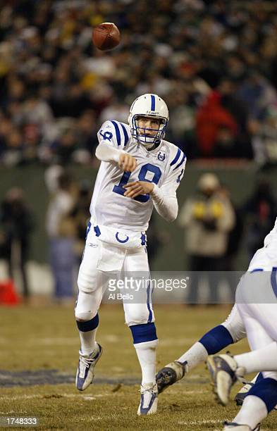 Peyton Manning of the Indianapolis Colts throws a pass against the New York Jets during the AFC wildcard game at Giants Stadium on January 4 2003 in...