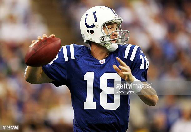 Peyton Manning of the Indianapolis Colts throws a pass against the Oakland Raiders during the game at the RCA Dome on October 10 2004 in Indianapolis...