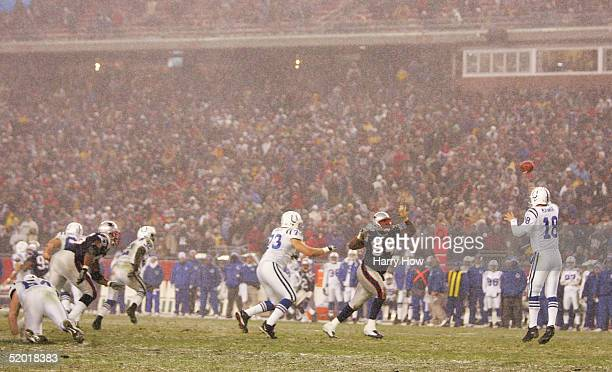 Peyton Manning of the Indianapolis Colts throws a pass against the New England Patriots during the AFC divisional playoff game at Gillette Stadium on...