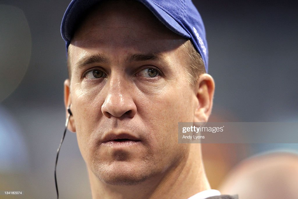 Peyton Manning of the Indianapolis Colts watches the action during the game against the Carolina Panthers at Lucas Oil Stadium on November 27, 2011 in Indianapolis, Indiana.